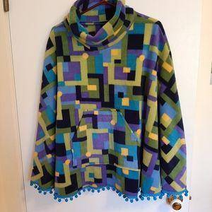 Handmade colorful poncho with pom pom trim
